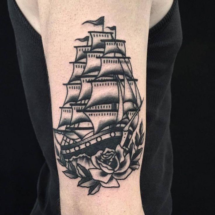 Traditional full-rigged ship tattoo on the right upper arm. Tattoo Artist: Anem