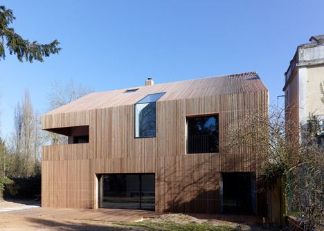 Maison 2G. French studio Avenier & Cornejo Architectes has used strips of cedar cladding to wrap every surface of this house in Orsay, France