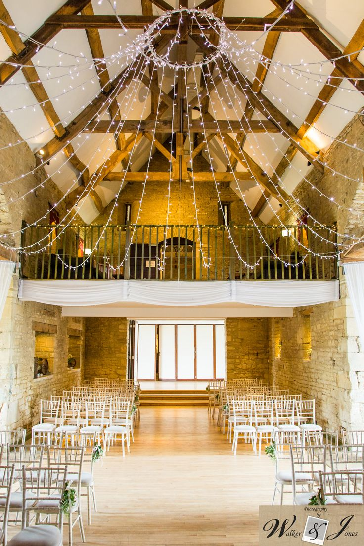 The Great Tythe Barn - Ceremony Room. Rustic decorations and lights