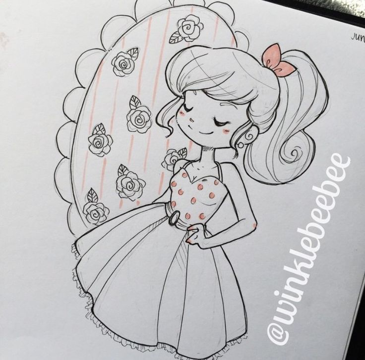 Cute girl in dress drawing