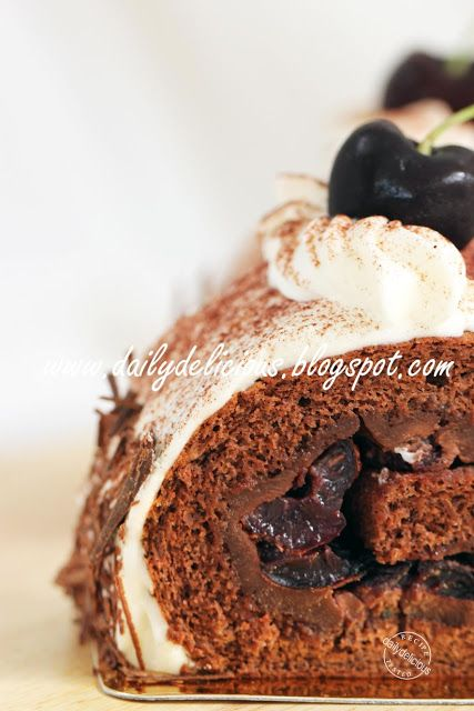 dailydelicious: Black forest Rolled Cake, La forêt noire roulade: My (not) traditional yule log cake.