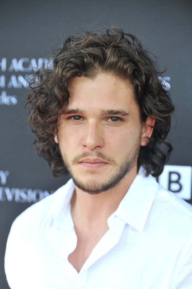 Kit Harrington.  Yes.  More please.  :-D  Love Game of Thrones for many reasons.