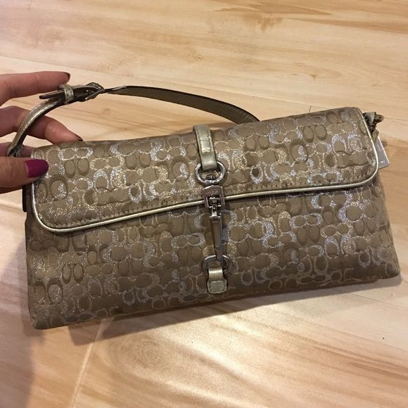 Authentic coach metallic bag This has been pre-owned with love. Please look at 2nd pic as there is a water stain and the inside has some dirt marks as well. I have a brand new one in my listing as well!!! Coach Bags