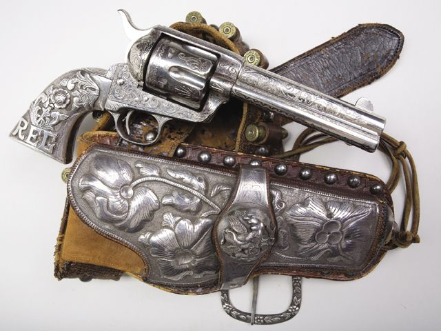 Engraved Colt Single Action Army Revolver with Silver-Mounted Grips, with Mexican Silver-Mounted Holster Rig.