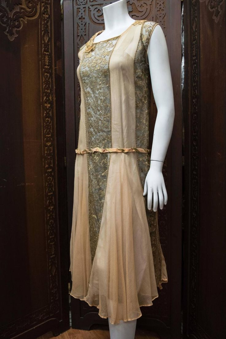 1920s Lace and Silk Georgette Dress Early 1920s dress made from gold lamé lace threads featuring a peach silk georgette inserts, matching peach silk slip, and drop waist peach velvet belt. Front 3/4 view - Left side 3