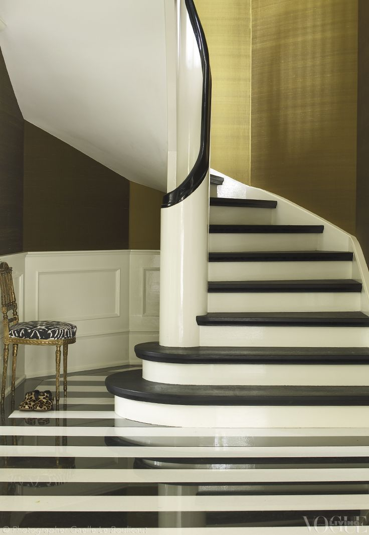 These stairs in black-stained oak make for a dramatic entrance. Photograph by Gaelle Le Boulicaut.
