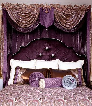 Elegant Purple Room Set - Purple meets passion with this ornate design. From the scrolled, antique style hardware to the smooth, luxurious fabrics, it's the epitome of glitz and glamour. The rich shades of plum, purple, and mauve contrast with the bronzed metallic accents. Topped of with beautiful, paisley print bedding and lavish cushions, this bed set has a grandeur essence that utterly captivating. Photo Credit: Samantha Day - Brandi Renee Designs, LLC - www.brandireneedesigns.com