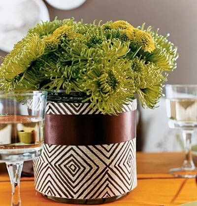 """Keep It Simple     """"I like to get several stems of one type of flower from the grocery store,"""" says Fran. """"I like a mass of one thing clumped together."""" For these arrangements, she used about four bunches of green mums and covered a simple container with a scrap of fabric and ribbon."""