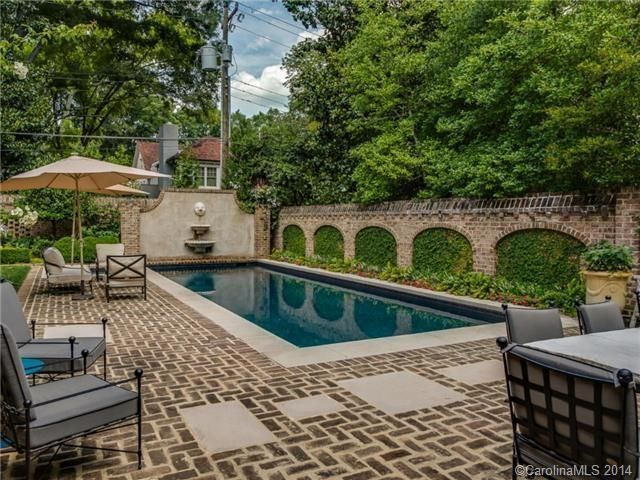 You'd need a really large space to be able to incorporate patio work with a pool, but if you've got it, flaunt it! This patio design features multi-colored bricks that have cut out throughout the design to add that extra interesting design layer. The pool looks great in the center of the scene with the decor circle around it, but it's also nice that there is more to the whole patio area than the fact that there is a pool in it. There are a lot of intriguing elements in this design.