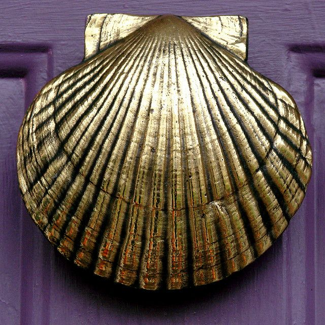 Scalloped door knocker  (This would be better than the Scottish man in a kilt playing the bag pipes door knocker that was here when we bought the house!  ~M)