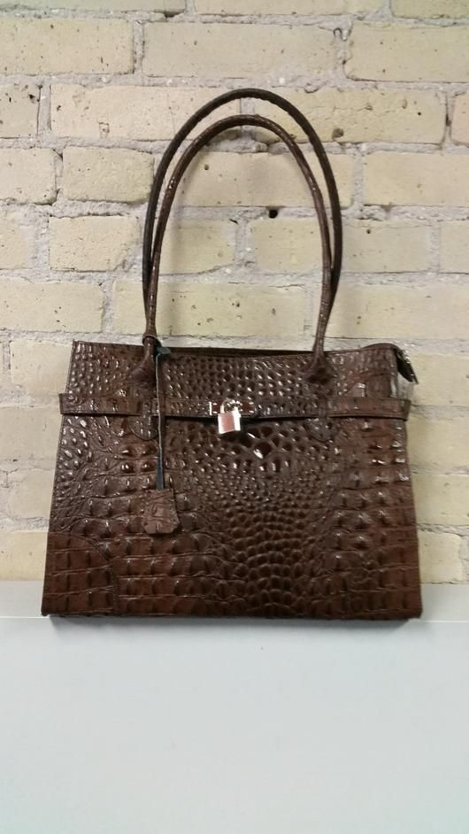 Brown Leather Tote  Check out our totes here: http://www.shopsydneygittermanfurs.ca/products/brown-leather-tote