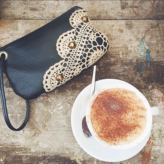 Leather wristlet with vintage crochet embellishment and antique dome studs.