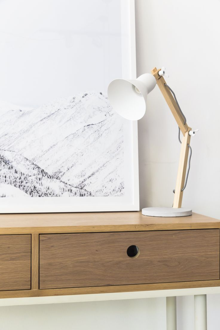 We love these timber and white accents in our Apartment, these details include the classic Frida Lamp and scenic Mountains Print.