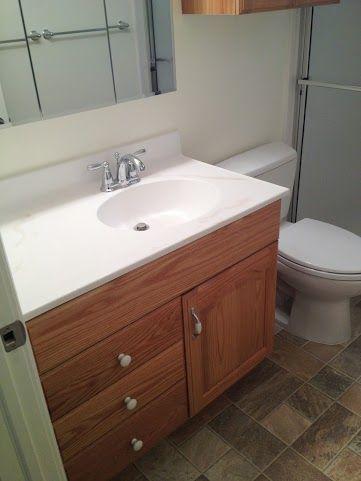 Bathroom Remodel Standard Sink White Countertop Tan Wooden Cabinets