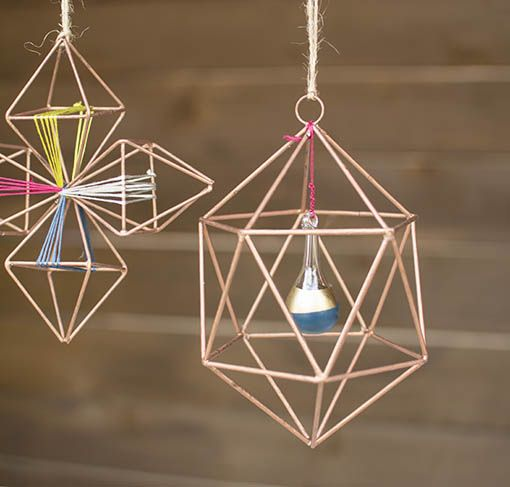 Hang a DIY painted glass drop ornament as a dimensional, dynamic component to your geometric ornaments!