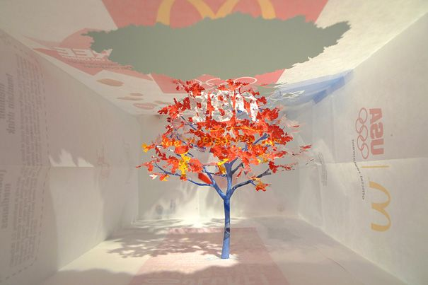 Tree carved from a mac ds box.  Amazing paper art on this page, amazing site.  Boredpanda.com
