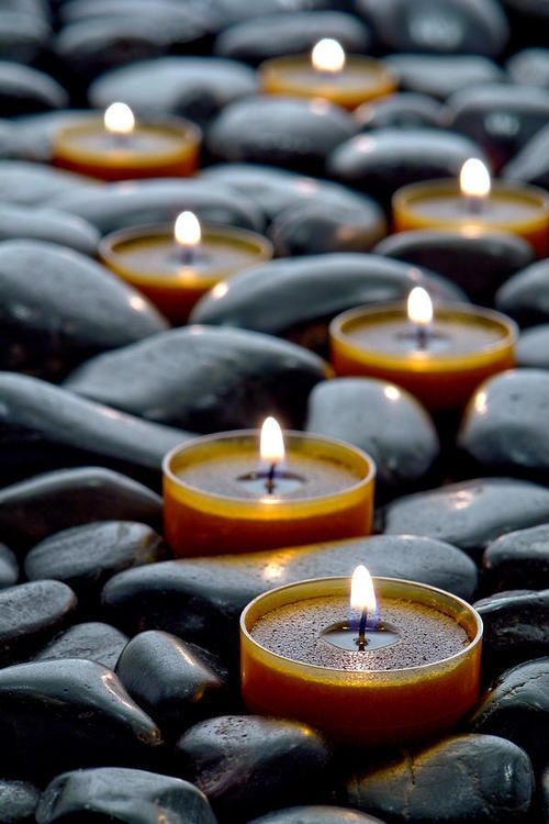 velas candles in a bed of stones
