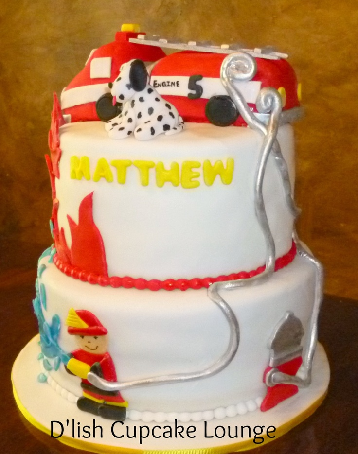 Fireman theme 2 tier cake...firetruck made from rice crispie treats...By D'lish Cupcake Lounge