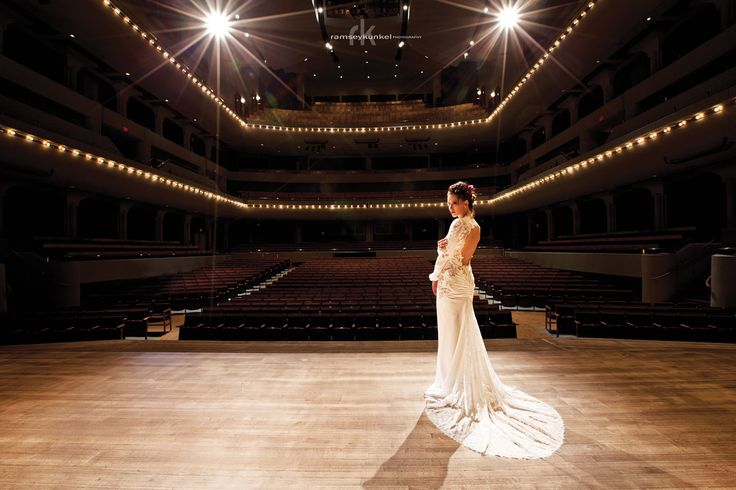 Bride on stage at the Jack Singer Concert Hall in Arts Commons - Calgary, AB