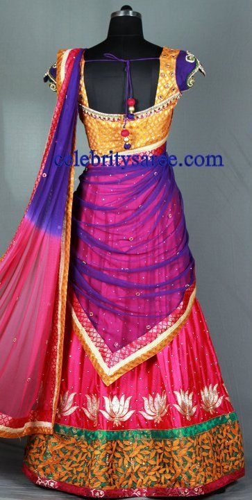 Lotus flowers in whitesilver and a blouse in gold with purple cupsleeves. Heavy border with emerald edging to offset the hotpink. Purple and hotpink ombre dupatta, oh this is f'er sure a lengha to dance a night away in during Navratri.