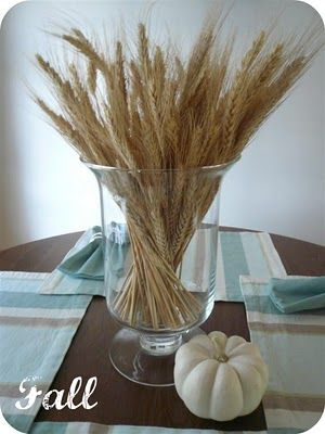 Easy fall decor with a wheat sheaf and white pumpkins.
