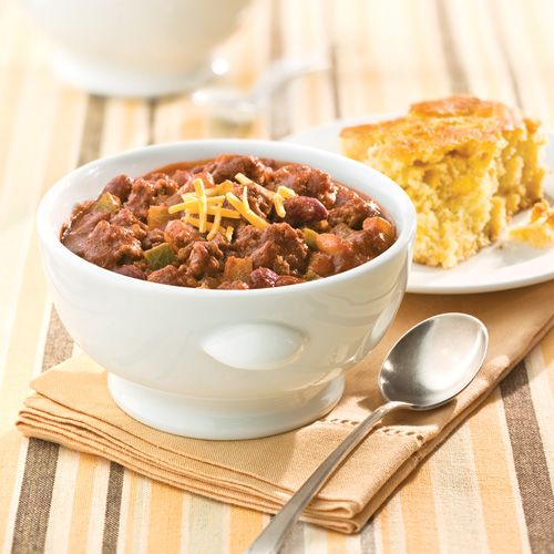 Beef Chili. A little sweet with two bottles of chili sauce. Try with 1 bottle and can of diced tomatoes.