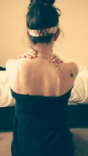 Dandelion and swallows shoulder tattoo. After two years I still love it!