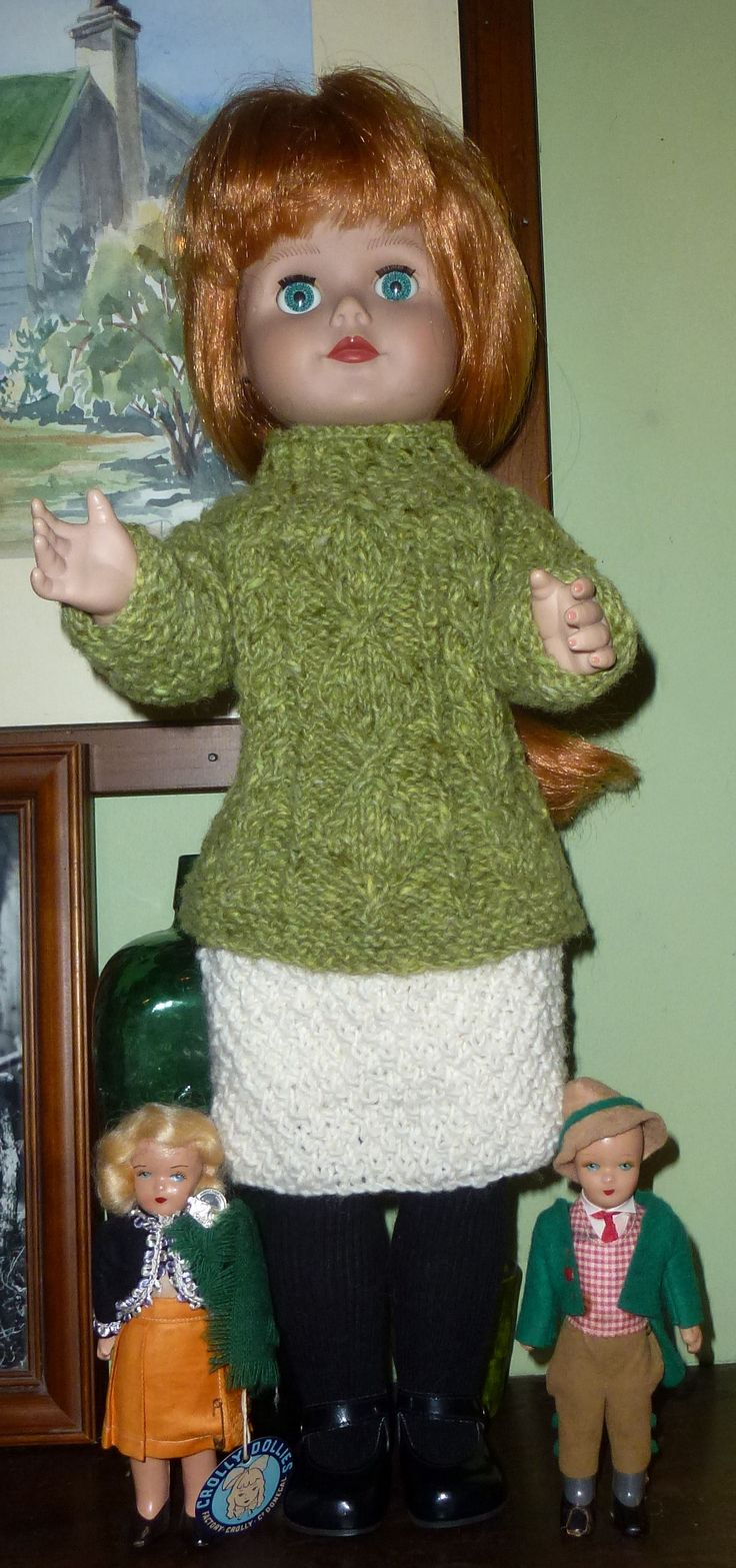 Ciara, Crolly Playdoll from the 1990s, flanked by two wee Crolly dollies from the 1950s. The Playdoll came without her skirt and with her top full of holes so, using the catalogue as my reference, I knitted exact copies of the clothing, using the same Donegal wool.