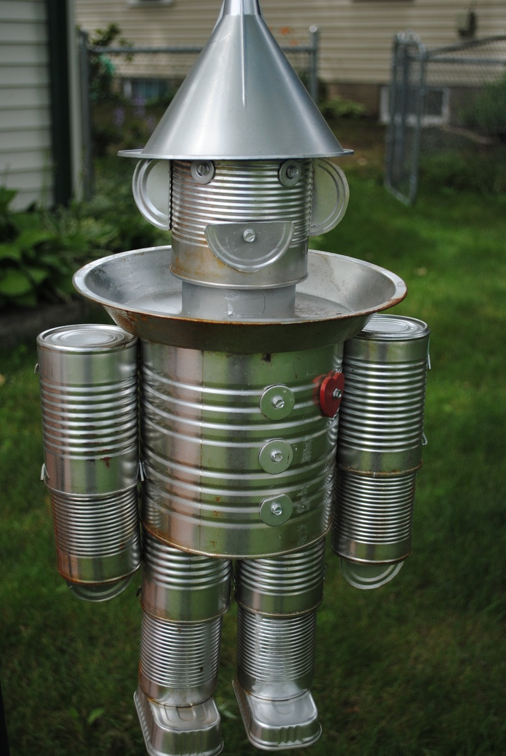 tin man bird feeder made out of soup cans pie tin