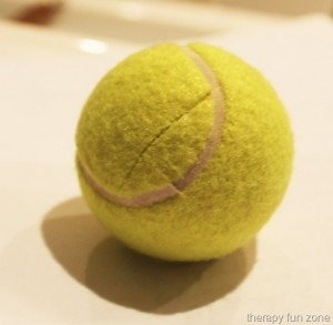 Pinch the ball and feed it! So cute; especially if the kids get to draw a face on it....great activity for kiddos that have low muscle tone in hands and can't squeeze!