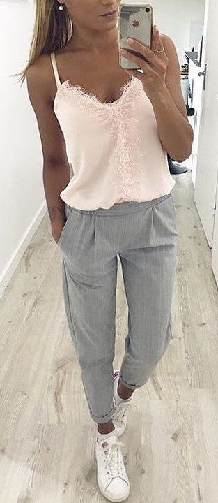 #spring #outfits woman in pink spaghetti-strap blouse and grey pants. Pic by @fashionative