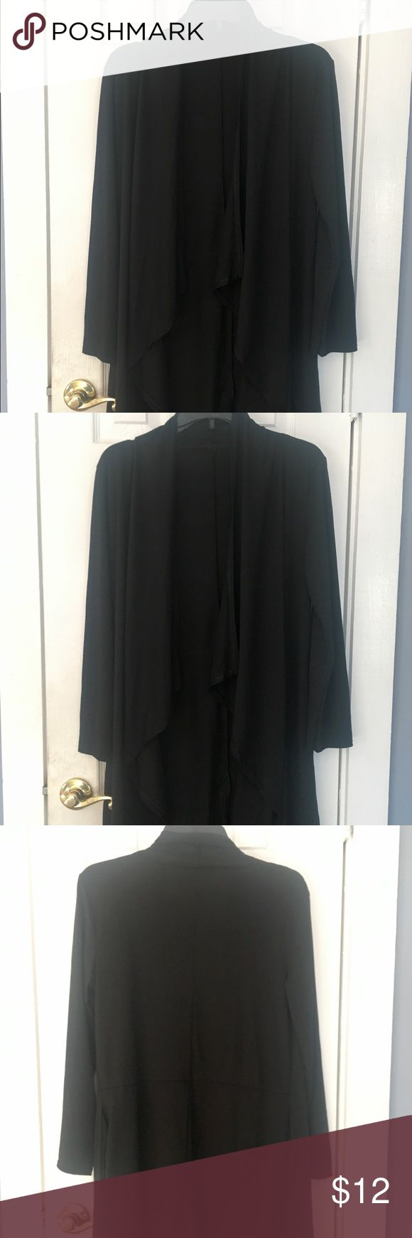 Black Cardigan/long open top-S-New New/never worn black long cardigan top with ruched front. The top hangs to knees and had no label. I purchased it off Groupon for $33 but it is too big on me as I am an XS. Please message me for more information or pictures. This has never been worn. Looks great with jeans or leggings. I gladly bundle items for shipping so please check out my other great items. Thank you for looking. Tops