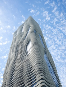 """Aqua Tower in Chicago - """"swells,"""" """"waves,"""" give every apartment a balcony that doubles as solar shading for the unit below. Irregular, rippling shapes of the facades also break up the fierce Chicago wind,"""