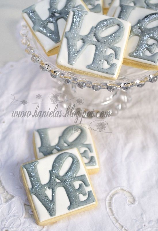"""Tutorial from Hanielas.  LOVE cookies.  Trying these at home. I found the letters look plain (like she does them here), omitting the darker shadows of the letters behind.  Looks too """"busy"""""""