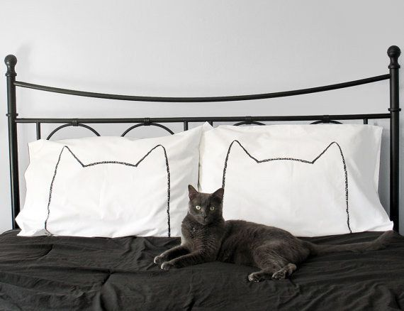 These cushion covers will let anyone coming into your bedroom know that the cat always comes first.