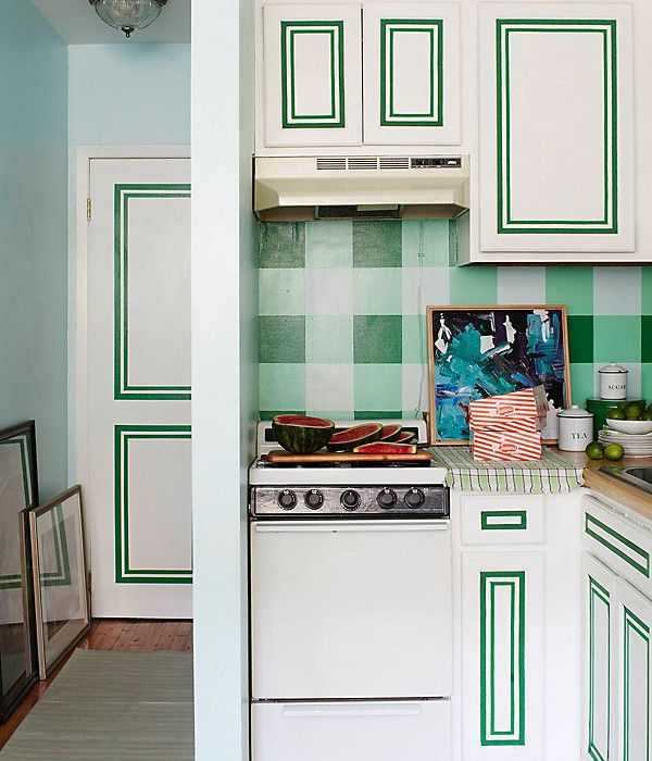 Obsessed with the green and white details in this small kitchen space!