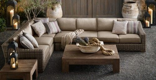 Nautically themed living room furniture with pot of coiled rope as coffee table centerpiece.