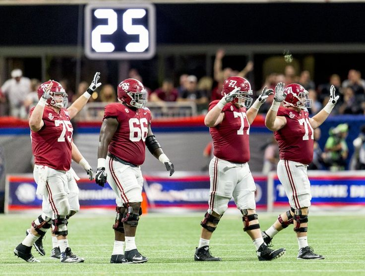 Alabama offensive lineman Bradley Bozeman (75), Matt Womack (77) and Ross Pierschbacher (71) signal the fourth quarter during the second half of the Alabama vs. Florida State football game, Saturday, Sept. 2, 2017, at Mercedes-Benz Stadium in Atlanta. Vasha Hunt/vhunt@al.com