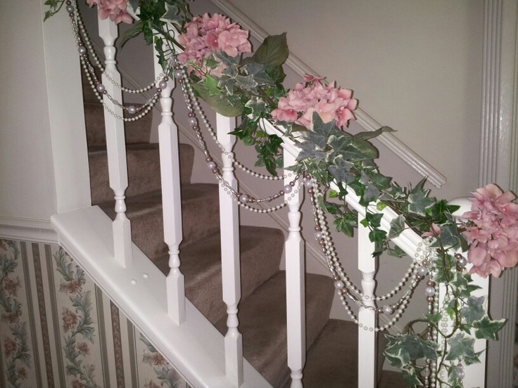 Spiff up a stair rail with hydrangeas ivy christmas for Stair railing decorated for christmas