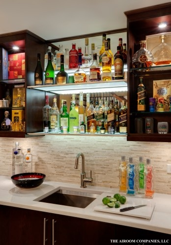 Awesome bar.  Contemporary basement by Airoom.com Architects-Builders-Remodelers.... Yess please can I do that NOW to my place!