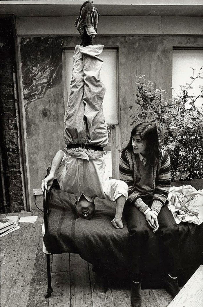 Freud's legacy:  Lucian Freud standing on his head in his studio with his daughter, the fashion designer Bella Freud, pictured in 1983