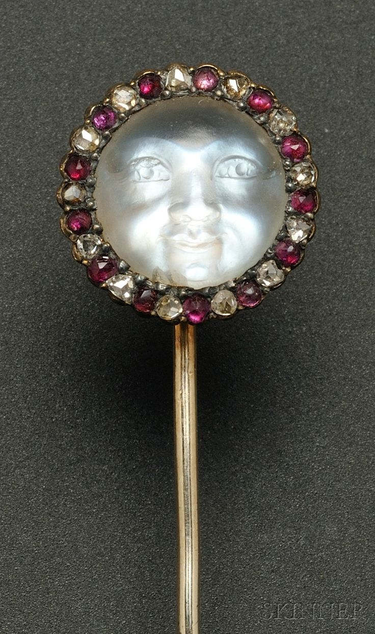 Antique Carved Moonstone Stickpin, depicting a moon face, framed by rubies and rose-cut diamonds, gold and silver mount, lg. 2 7/8 in. boxed.