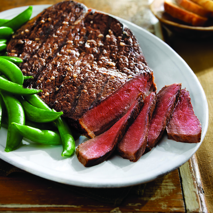 This is a fun and easy recipe from the Beef Council that takes an inexpensive top round steak and dresses it up with a tangy lime sauce for extra flavor.