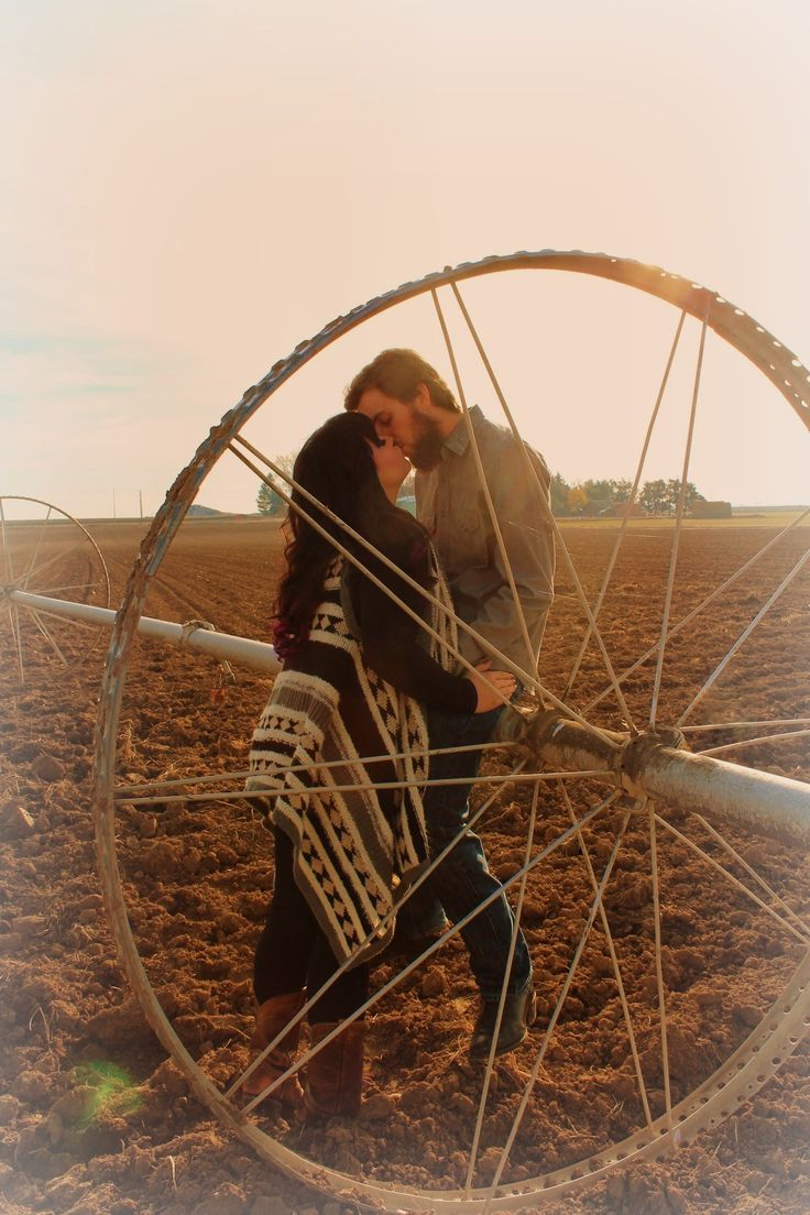 #engagement #session #photography #photoshoot #photo #shoot #country #farm #rustic #sprinkler #fall