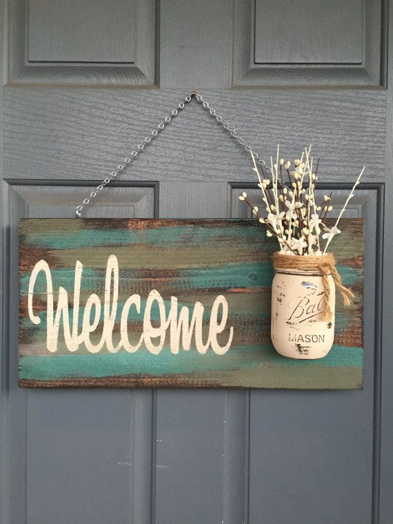Outdoor Teal & Green Welcome Sign - Size is approximately 12 X 18 inches - Comes ready to hang - Light sealer applied - New Wood -Flowers NOT included - Custom font color (you pick) FONT COLORS: Tan, White, Yellow, Black, gray, or green *Other colors upon request.