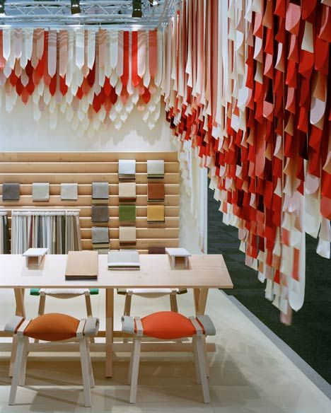 London-based design duo Raw Edges arranged hundreds of fabric ribbons around the edge of their display stand for Danish textile manufacturer Kvadrat at the Stockholm Design Week 2013