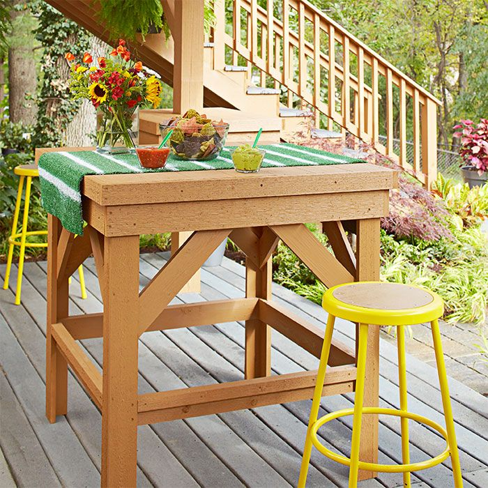 spend game day with friends in a patio space where sports bar meets tailgate party lowes creative ideas