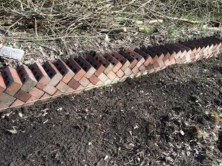 Old bricks being reused to create the original rose garden walls