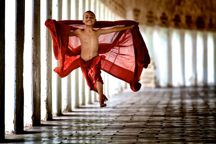 """Young monks begin their service very early in life in their studies in the monastery. This monk was young and energetic and decided to """"fly"""" in his exuberance for life. Picture by Bonnie Stewart"""