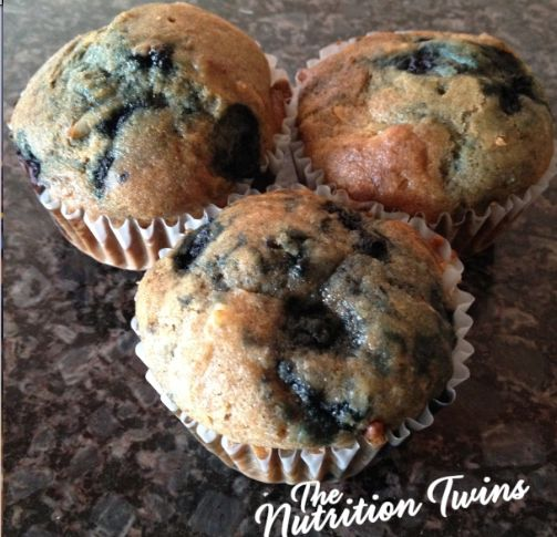 Whole Wheat Blueberrilicious Coconut Muffins | Only 116 Calories | Great way to squash a sweet tooth! | Healthy dessert | Made with whole wheat pastry flour and @egglandsbest .client | For MORE RECIPES, fitness & nutrition tips please SIGN UP for our FREE NEWSLETTER www.NutritionTwins.com
